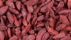 Dried Goji Berries.  Front of the camera rotates plate with bright berries Goji Stock Footage
