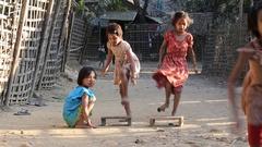 Poor children playing outdoor game on the street.  Burma, Myanmar Stock Footage