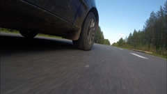 The car rides on paved road in the forest. Stock Footage