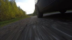Autumn forest . The car goes on the road paved. Stock Footage