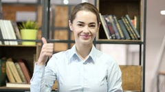 Thumbs Up By Woman, Indoor Office Stock Footage