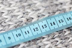 Close up of knitted item with measuring tape Stock Photos