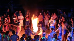 Girls and boys dancing the Full Moon party in island Koh Phangan. Thailand Stock Footage