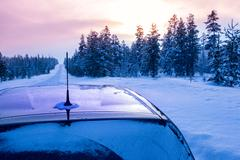Winter Sunset and the Car is on Empty Road Stock Photos