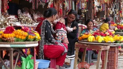 Women and children selling souvenirs and jewelery to tourists, Kathmandu. Nepal Stock Footage