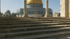Tilt up shot of women walking towards dome of the rock in jerusalem Stock Footage