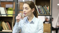 Woman Drinking Water, Indoor Office Stock Footage