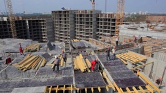 Construction of new buildings, the workers is poured the formwork. Stock Footage