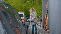 Woman Filling Full Tank at Gas Station Arkistovideo