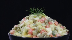 Healthy homemade russian traditional salad olivier ready to eat, close up Stock Footage