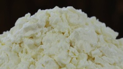 Cottage cheese in plate. Rotates plate with cottage cheese . Close up Stock Footage
