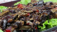 Baked eggplant with onions, garlic, red hot chili pepper and walnuts , close up Stock Footage