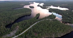 Flying over Finland lakes by sunset Stock Footage