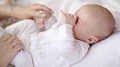 Sleepy Infant on Mothers Laps Stock Footage