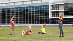 Sportswomen Stretching on Grass Stock Footage