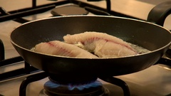 Melting butter baking fresh fish on gas flame Stock Footage