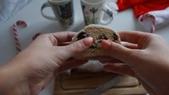 Food, baking, people and unhealthy eating concept - close up of woman hands with Stock Footage