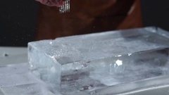 The bartender crushing ice with special fork and breaking off a big piece of ice Stock Footage