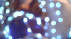 Beautiful sexy redhead girl shrouded in a luminous christmas light bulbs. Stock Footage