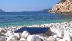 Lost smartphone and stunning sea view Stock Footage