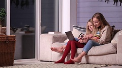 Mother gives online shopping education to daughter Stock Footage
