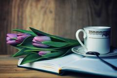 Reading book with tea flower and sweet Stock Photos
