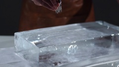 The bartender crushing ice with special fork Stock Footage