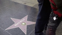 Bruce Willis star on street tourist posing picture Freddy Krueger Hollywood LA Stock Footage