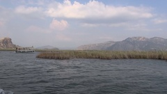 Reeds and Sightseeing tour boat on the lake Dalyan Stock Footage