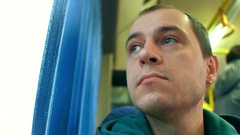 Caucasian man looking through the bus window. Transportation or travel concepts Stock Footage