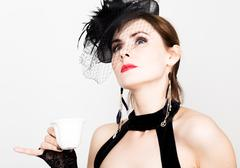 Glamor girl with a cup of coffee. fashion woman drinks coffe or hot tea Stock Photos