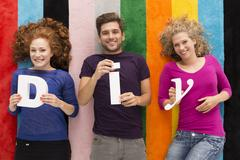 """Group of people holding 'DIY"""" letters Stock Photos"""
