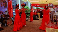 Closeup Hostesses in National Dresses Dance on Stage in Vietnam Stock Footage