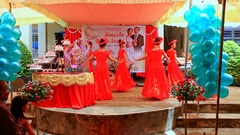 Vietnamese Hostesses in National Dresses Dance on Stage Stock Footage