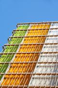 Modern multi colored glass building. Exterior of the local commercial store Stock Photos