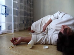 Woman lies on the floor after the suicide. Stock Footage