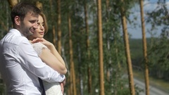 Happy honeymooners posing in the park Stock Footage