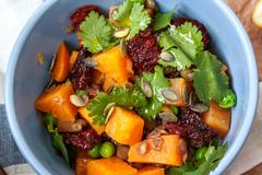 Salad with baked sweet potatoes, avocados, lentils, dried tomatoes, Stock Photos