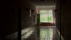 A school teacher leaves the classroom and closes the door in the hallway Stock Footage