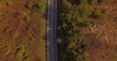 Traffic Through A Country Road, Aerial Car transporter trucks and cars. Stock Footage
