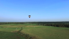 Air baloon over green lands Stock Footage