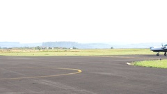 Executive twin-engine airplane taxiing in empty airport Stock Footage