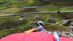 Casualty eye-view of mountain rescue as stretcher lowered feet first down cliff Stock Footage