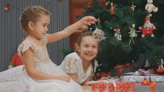 Girls looking at the most beautiful Christmas ball, New Year Stock Footage