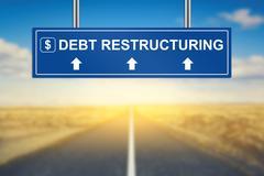 Debt restructuring words on blue road sign Kuvituskuvat