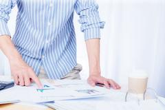 Businessman analyze the charts and graphs showing the results startup success Stock Photos