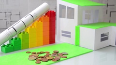 Woman places light bulb on money, cubes symbolize energy classes. Stock Footage
