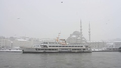 Winter at Istanbul with a passenger ship berthed in Eminonu Pier Stock Footage