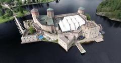 Flying around Olavinlinna Castle in Savonlinna Stock Footage