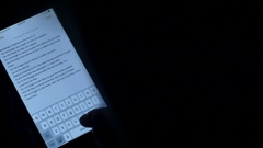 Woman Writing Notes On Her Tablet Computer In The Middle Of The Night, Insomnia Stock Footage